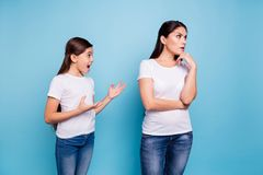 Close up photo two people brown haired mum disinterested ignoring small little daughter yelling ask chat speak tell talk. Mistakes sorry wear white t-shirts royalty free stock photos