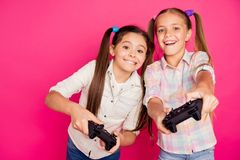 Close up photo two people little age she her girls hold hands arms trying hard to win game not lose loser winner wear stock image