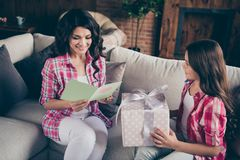 Close up photo two people mum little daughter giving present box card with mommy poem unexpected sweet cute reading. Delighted wear pink plaid shirts flat stock images