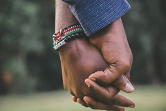 close-Up Photo of Two Person's Holding Hands