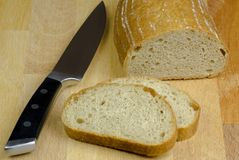 Close-up photo of two slices of bread cut by knife with black ha Stock Photography