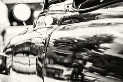 Close up photo of veteran car with rear-view mirror and handle, Royalty Free Stock Photography