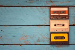 Close up photo of vintage cassette tape over aqua wooden table . top view. retro filtered Royalty Free Stock Images