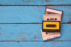 Close up photo of vintage cassette tape over aqua wooden table . top view. retro filtered Stock Image