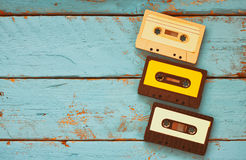 Close up photo of vintage cassette tape over aqua wooden table . top view. retro filtered Stock Images