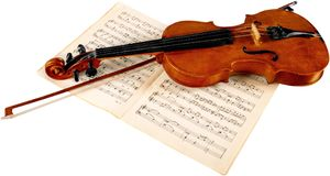 Close-up Photo Of Violin And Musical Notes. Music musical notes violin play graphic paper royalty free stock images