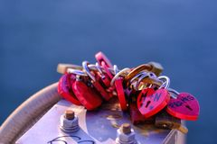 Heart shape colorful wedding padlocks. Close up photo of wedding padlocks: lots of colorful heart shape metal wedding padlocks are hanged at some bridge element royalty free stock photography
