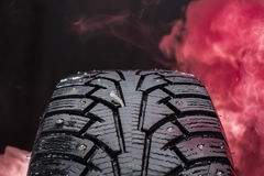 Close up photo of winter tire with a nail in Finland. Stock Image