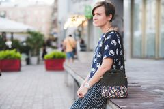 Close up photo of woman bag in hands of fashionable woman Royalty Free Stock Images