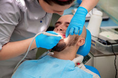 Close up photo of Woman dentist checks the teeth of her patient Royalty Free Stock Photography