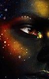 Close up photo of woman eye and dark face art Stock Photos