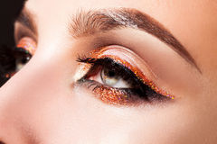 Close up photo of woman eyes with professional make up Stock Image