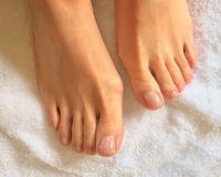 Close up photo of woman feet and toes on a white towel stock photo