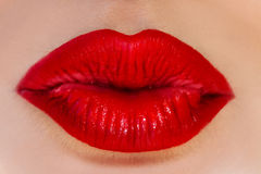 Close up photo of woman lips in red lipstick. Air kiss Stock Photo