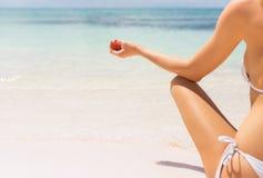 Close-up photo of woman meditating on the beach stock photos