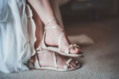Close-Up Photo of Woman Wearing Flat Sandals