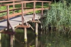Wooden bridge, close-up. A close-up photo of a wooden bridge across the river Stock Photos
