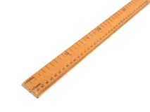 Close up photo of a wooden meteric ruler on a white dackground.  Royalty Free Stock Images