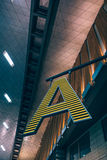 Close Up Photo of a Yellow and Teal a Letter Hanging Stock Images