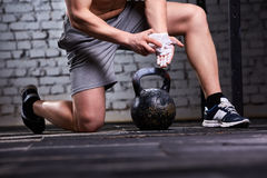 Close-up photo of young athlete man getting ready for crossfit training against brick wall. Royalty Free Stock Photography
