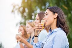 Close up photo of young beautiful women eating ice cream royalty free stock photography