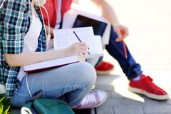 Close up photo of young happy students with books and notes outdoors Stock Images