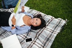 Close-up photo of young pretty asian student, holding book, look Royalty Free Stock Image
