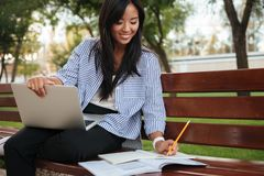 Close-up photo of young smiling asian female student, taking not Royalty Free Stock Images