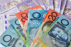 Close-up photograph of Australian dollars and Malaysia's ringgit Malaysia. A close-up photograph of Australian dollars and Malaysia's ringgit Malaysia currency Stock Image