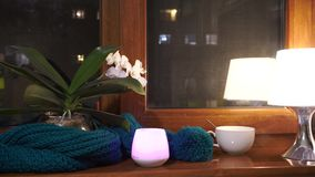 Cozy Candle Light Glowing In The Dark By The Window And The Lamp . Cozy Candle Light Glowing In The Dark By The Window. stock footage