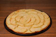 Close up photograph of a freshly made apple pie with apple slices. Close up photograph of a freshly made apple pie on cook board Stock Image
