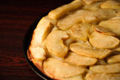 Close up photograph of a freshly made apple pie with apple slices. Close up photograph of a freshly made apple pie on cook board Stock Images