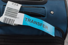 Close up photograph of luggage with transfer label. Close-up photograph of luggage with transfer label at airport with blurred background. Problems with transfer Stock Photos