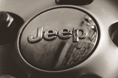 Jeep metal emblem. Close up photograph of a metal Jeep badge or emblem Stock Photos