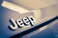 Jeep metal emblem. Close up photograph of a metal Jeep badge or emblem Royalty Free Stock Image