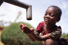 Free Close Up Photograph Of African Black Girl Drinking Safe Water From Tap Royalty Free Stock Photo - 172697605