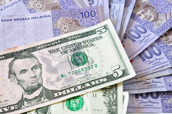 Close-up photograph of United States dollars and Malaysia's ringgit malaysia Stock Images
