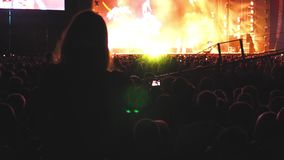 Close up of photographing shooting with smartphone during a concert party open air fest 4k. Close up of photographing shooting with smartphone during a concert stock video footage