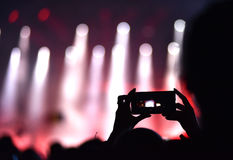 Close up of photographing with smartphone during a concert Stock Photography