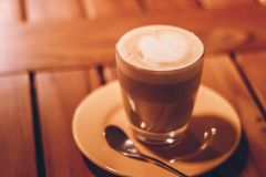 Close-up Photography of Clear Glass Cup With Latte and Tablespoon Royalty Free Stock Photography