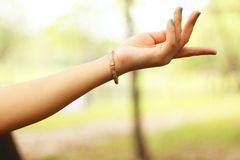 Close-Up Photography of Girl's Left Hand Wearing Bracelet Royalty Free Stock Image