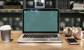 Close-Up Photography of Macbook Near Mobile Phone And Headset stock photos