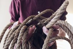 Close-up Photography of Man Holding a Rope Stock Photos