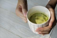 Close-up Photography of Person Holding Ceramic Mug Stock Photo