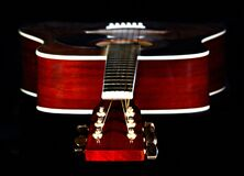 Close Up Photography of Red Wooden Guitar Head Stock Stock Photo