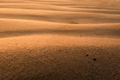 Close up photography of sand waves as abstract background. Wallpaper royalty free stock image