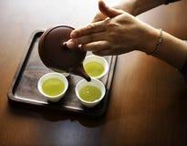Close-up Photography of Teapot Pouring Tea Royalty Free Stock Photos