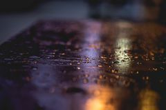 Close Up Photography of Water Droplets on Wooden Surface stock photo