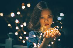 Close-Up Photography of Woman Holding Sting Lights royalty free stock photo