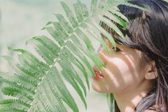 Close-Up Photography of Woman Near Fern Stock Image